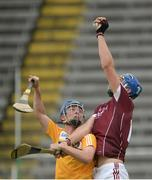 23 July 2016; Cian Salmon of Galway in action against Conor Carson of Antrim during their Electric Ireland GAA Hurling All-Ireland Minor Championship, Quarter-Final, game between Antrim and Galway at Kingspan Breffni Park in Co Cavan. Photo by Oliver McVeigh/Sportsfile