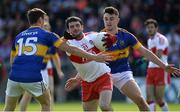 23 July 2016; Oisin Duffy of Derry in action against Conor Sweeney and Michael Quinlivan of Tipperary during their GAA Football All-Ireland Senior Championship, Round 4A, game at Kingspan Breffni Park in Co Cavan. Photo by Oliver McVeigh/Sportsfile