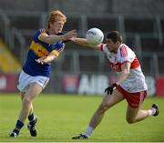 23 July 2016; Josh Keane of Tipperary in action against Ciaran McFaul of Derry during their GAA Football All-Ireland Senior Championship, Round 4A, game at Kingspan Breffni Park in Co Cavan. Photo by Oliver McVeigh/Sportsfile