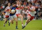 23 July 2016; Philip Austin of Tipperary in action against Mark Lynch of Derry during their GAA Football All-Ireland Senior Championship, Round 4A, game at Kingspan Breffni Park in Co Cavan. Photo by Oliver McVeigh/Sportsfile