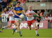 23 July 2016; Conor Sweeney of Tipperary in action against Ciaran Mullan of Derry during their GAA Football All-Ireland Senior Championship, Round 4A, game at Kingspan Breffni Park in Co Cavan. Photo by Oliver McVeigh/Sportsfile