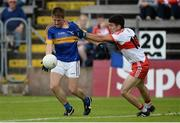23 July 2016; Bill Maher of Tipperary in action against Danny Heavron of Derry during their GAA Football All-Ireland Senior Championship, Round 4A, game at Kingspan Breffni Park in Co Cavan. Photo by Oliver McVeigh/Sportsfile