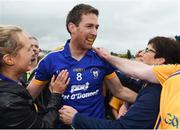 23 July 2016; Gary Brennan of Clare celebrates with supporters after victory in the GAA Football All-Ireland Senior Championship, Round 4A, game between Clare and Roscommon at Pearse Stadium in Salthill, Galway. Photo by Brendan Moran/Sportsfile