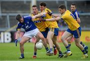 23 July 2016; Gordon Kelly of Clare in action against, from left, Seá McDermott, Diarmuid Murtagh and Fintan Cregg of Roscommon during the GAA Football All-Ireland Senior Championship, Round 4A, game between Clare and Roscommon at Pearse Stadium in Salthill, Galway. Photo by Brendan Moran/Sportsfile