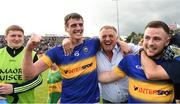23 July 2016; Conor Sweeney and Kevin O'Halloran of Tipperary celebrates with supporters after the final whistle of the GAA Football All-Ireland Senior Championship, Round 4A, game at Kingspan Breffni Park in Co Cavan. Photo by Oliver McVeigh/Sportsfile