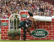 23 July 2016; Eoin McMahon of Ireland, competing on Kings Lux, fails to clear the wall during the The Land Rover Puissance at the Dublin Horse Show in the RDS, Ballsbridge, Dublin. Photo by Sam Barnes/Sportsfile