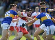 23 July 2016; Oisin Duffy of Derry in action against Conor Sweeney, Peter Acheson and Michael Quinlivan of Tipperary during the GAA Football All-Ireland Senior Championship, Round 4A, game at Kingspan Breffni Park in Co Cavan. Photo by Oliver McVeigh/Sportsfile
