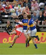 23 July 2016; Danny Haveron of Derry in action against Brian Fox of Tipperary during the GAA Football All-Ireland Senior Championship, Round 4A, game at Kingspan Breffni Park in Co Cavan. Photo by Oliver McVeigh/Sportsfile