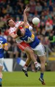 23 July 2016; James Kielt of Derry in action against Michael Quinlivan of Tipperary during the GAA Football All-Ireland Senior Championship, Round 4A, game at Kingspan Breffni Park in Co Cavan. Photo by Oliver McVeigh/Sportsfile