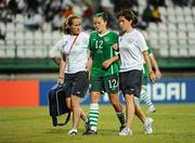 13 September 2010; Stacie Donnelly, Republic of Ireland, is assisted off the pitch by physiotherapist Ursula Brooks and team doctor Suzi Clarke. FIFA U-17 Women's World Cup Group Stage, Republic of Ireland v Ghana, Dwight Yorke Stadium, Scarborough, Tobago, Trinidad & Tobago. Picture credit: Stephen McCarthy / SPORTSFILE