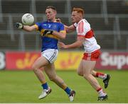 23 July 2016; Peter Acheson of Tipperary in action against Conor McAtamney of Derry during the GAA Football All-Ireland Senior Championship, Round 4A, game at Kingspan Breffni Park in Co Cavan. Photo by Oliver McVeigh/Sportsfile
