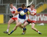 23 July 2016; Conor Sweeney of Tipperary in action against Ciaran McFaul and Brendan Rogers of Derry during the GAA Football All-Ireland Senior Championship, Round 4A, game at Kingspan Breffni Park in Co Cavan. Photo by Oliver McVeigh/Sportsfile