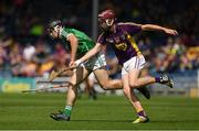 24 July 2016; Ciarán O'Connor of Limerick in action against Mark O'Neill of Wexford during the Electric Ireland GAA Hurling All-Ireland Minor Championship quarter final match between Wexford and Limerick at Semple Stadium in Thurles, Co Tipperary. Photo by Ray McManus/Sportsfile