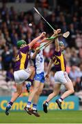24 July 2016; Tadhg de Burca of Waterford in action against Conor McDonald, left, and Harry Kehoe of Wexford during the GAA Hurling All-Ireland Senior Championship quarter final match between Wexford and Waterford at Semple Stadium in Thurles, Co Tipperary. Photo by Stephen McCarthy/Sportsfile
