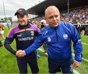24 July 2016; Wexford manager Liam Dunne, left, and Waterford manager Derek McGrath following the GAA Hurling All-Ireland Senior Championship quarter final match between Wexford and Waterford at Semple Stadium in Thurles, Co Tipperary. Photo by Stephen McCarthy/Sportsfile