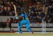 24 July 2016; Zouks batsman Johnson Charles hits six during Match 23 of the Hero Caribbean Premier League match between St Lucia Zouks and Guyana Amazon Warriors at the Daren Sammy Cricket Stadium in Gros Islet, St Lucia. Photo by Ashley Allen/Sportsfile