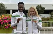 25 July 2016; Gina Akpe-Moses, left, with her silver medal from the 100 meter final and Molly Scott, right with her bronze medal from the 100 meter hurdles from the Ireland Athletics team on their return from IAAF World Junior Athletics Championships at Dublin Airport in Dublin. Photo by Eóin Noonan/Sportsfile