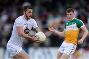 9 July 2016; Johnny Byrne of Kildare gets past Seán Pender of Offaly during the GAA Football All-Ireland Senior Championship - Round 2B match between Kildare and Offaly at St Conleth's Park in Newbridge, Kildare.  Photo by Piaras Ó Mídheach/Sportsfile