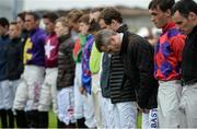 26 July 2016; Pat Smullen, third from right, and fellow jockeys observe a minute of silence for the late jockey John Thomas McNamara after race one at the Galway Races in Ballybrit, Co Galway. Photo by Cody Glenn/Sportsfile