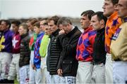 26 July 2016; Pat Smullen, centre, and fellow jockeys observe a minute of silence for the late jockey John Thomas McNamara after race one at the Galway Races in Ballybrit, Co Galway. Photo by Cody Glenn/Sportsfile