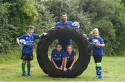 27 July 2016; Rob Kearney of Leinster with participants, left to right, Cillian McCarthy, aged 10, from Walkinstown, Co Dublin, Daniel O'Shea, aged 10, from Lucan, Co Dublin, Olivia Campbell, aged 9, from Tallaght, Co Dublin, and Adara Carthy, aged 9, from Celbridge, Co Kildare, during the Bank of Ireland Leinster Rugby Summer Camp at Clondalkin RFC in Kingswood Cross, Dublin. Photo by Daire Brennan/Sportsfile