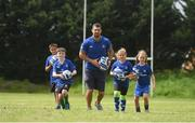 27 July 2016; Rob Kearney of Leinster with participants, left to right, Daniel O'Shea, aged 10, from Lucan, Co Dublin, Cillian McCarthy, aged 10, from Walkinstown, Co Dublin, Adara Carthy, aged 9, from Celbridge, Co Kildare, and Olivia Campbell, aged 9, from Tallaght, Co Dublin, during the Bank of Ireland Leinster Rugby Summer Camp at Clondalkin RFC in Kingswood Cross, Dublin. Photo by Daire Brennan/Sportsfile