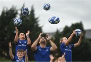 27 July 2016; Rob Kearney of Leinster with participants, left to right, Cillian McCarthy, aged 10, from Walkinstown, Co Dublin, Daniel O'Shea, aged 10, from Lucan, Co Dublin, Adara Carthy, aged 9, from Celbridge, Co Kildare, and Olivia Campbell, aged 9, from Tallaght, Co Dublin, during the Bank of Ireland Leinster Rugby Summer Camp at Clondalkin RFC in Kingswood Cross, Dublin. Photo by Daire Brennan/Sportsfile
