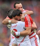 19 September 2010; Cork goalkeeper Alan Quirke, right, celebrates with team-mates Graham Canty, left, and Kieran O'Connor at the end of the game. GAA Football All-Ireland Senior Championship Final, Down v Cork, Croke Park, Dublin. Picture credit: David Maher / SPORTSFILE