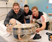 20 September 2010; Cork players, from left to right, Daniel Goulding, Paul Kerrigan, and Anthony Lynch with Max Doyle, aged 4, from Redcross, Co. Wicklow, during a team visit to Our Lady's Hospital for Sick Children, Crumlin, Dublin. Picture credit: Barry Cregg / SPORTSFILE