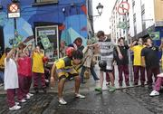 23 September 2010; Irish freestyle soccer players Dan Dennehy, left, and Pet Fleming with pupils, from James Street CBS, at the launch of the new sports brand Pele Sports. Pelé Sports launch, Temple Bar, Dublin. Picture credit: Matt Browne / SPORTSFILE