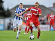 25 September 2010; Eoin Doyle, Sligo Rovers, in action against Don Tierney, Monaghan United. EA Sports Cup Final, Sligo Rovers v Monaghan United, The Showgrounds, Sligo. Picture credit: Barry Cregg / SPORTSFILE