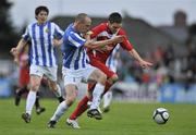 25 September 2010; John Russell, Sligo Rovers, in action against Alan Byrne, Monaghan United. EA Sports Cup Final, Sligo Rovers v Monaghan United, The Showgrounds, Sligo. Picture credit: Barry Cregg / SPORTSFILE