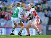 26 September 2010; Louth goalkeeper Caoimhe Breen is tackled by Maire Flanagan, Limerick. TG4 All-Ireland Junior Ladies Football Championship Final, Louth v Limerick, Croke Park, Dublin. Picture credit: Brendan Moran / SPORTSFILE
