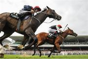 29 July 2016; Lost In Silence, with Pat Smullen up, on their way to winning the Guinness 17:59 European Breeders Fund Median Auction Maiden ahead of Delegating, with Colin Keane up, who finished second, at the Galway Races in Ballybrit, Co Galway. Photo by Cody Glenn/Sportsfile