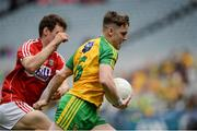 30 July 2016; JD Boyle of Donegal in action against Cathal Maguire of Cork during the Electric Ireland GAA Football All-Ireland Minor Championship Quarter-Final match between Donegal and Cork at Croke Park in Dublin. Photo by Oliver McVeigh/Sportsfile