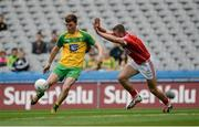 30 July 2016; Nathan O'Donnell of Donegal in action against Alan McCarthy of Cork during the Electric Ireland GAA Football All-Ireland Minor Championship Quarter-Final match between Donegal and Cork at Croke Park in Dublin. Photo by Oliver McVeigh/Sportsfile
