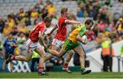 30 July 2016; Aidan McLaughlin of Donegal in action against Liam O'Donovan and Sean O'Sullivan of Cork during the Electric Ireland GAA Football All-Ireland Minor Championship Quarter-Final match between Donegal and Cork at Croke Park in Dublin. Photo by Oliver McVeigh/Sportsfile
