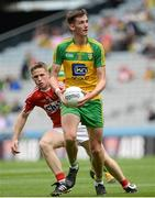 30 July 2016; Jason McGee of Donegal in action against Liam O'Donnovan of Cork during the Electric Ireland GAA Football All-Ireland Minor Championship Quarter-Final match between Donegal and Cork at Croke Park in Dublin. Photo by Oliver McVeigh/Sportsfile