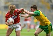 30 July 2016; Mark Buckley of Cork in action against Aaron Deeney of Donegal during the Electric Ireland GAA Football All-Ireland Minor Championship Quarter-Final match between Donegal and Cork at Croke Park in Dublin. Photo by Oliver McVeigh/Sportsfile