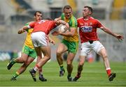 30 July 2016; Neil McGee of Donegal supported by Frank McGlynn in action against Tomas Clancy and Donncha O'Connor of Cork during the GAA Football All-Ireland Senior Championship Round 4B match between Donegal and Cork at Croke Park in Dublin. Photo by Oliver McVeigh/Sportsfile