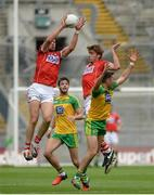 30 July 2016; Alan O'Connor of Cork supported by Ian McGuire in action against Odhran MacNiallais and Rory Kavanagh of Donegal during the GAA Football All-Ireland Senior Championship Round 4B match between Donegal and Cork at Croke Park in Dublin. Photo by Oliver McVeigh/Sportsfile