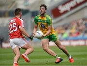 30 July 2016; Odhran MacNiallais of Donegal in action against Sean Powter of Cork during the GAA Football All-Ireland Senior Championship Round 4B match between Donegal and Cork at Croke Park in Dublin. Photo by Oliver McVeigh/Sportsfile