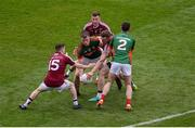 30 July 2016; Cillian O'Connor of Mayo in action against Westmeath players, left to right, John Connellan, Ger Egan, and Kieran Martin, during the GAA Football All-Ireland Senior Championship Round 4B match between Westmeath and Mayo at Croke Park in Dublin. Photo by Daire Brennan/Sportsfile