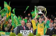26 September 2010; Donegal captain Aoife McDonnell lifts the cup after the game in the company of Pat Quill, President, Cumann Peil Gael na mBan. TG4 All-Ireland Intermediate Ladies Football Championship Final, Donegal v Waterford, Croke Park, Dublin. Picture credit: Brendan Moran / SPORTSFILE