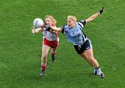 26 September 2010; Maria Kavanagh, Dublin, gets to the ball ahead of Catriona McGahan, Tyrone. TG4 All-Ireland Senior Ladies Football Championship Final, Dublin v Tyrone, Croke Park, Dublin. Picture credit: Brendan Moran / SPORTSFILE
