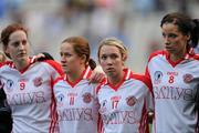 26 September 2010; Tyrone players Shannon Quinn, 9, Gemma Begley, 11, Clare Scullion, 17, and Sarah Donnelly watch the presentation to Dublin. TG4 All-Ireland Senior Ladies Football Championship Final, Dublin v Tyrone, Croke Park, Dublin. Picture credit: Ray McManus / SPORTSFILE