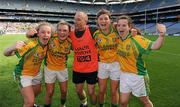 26 September 2010; Donegal players, from left, Kate Keeney, Eilish Ward, Ciara Hegarty and Geraldine McLoughlin celebrate with selector Barney Curran after the game. TG4 All-Ireland Intermediate Ladies Football Championship Final, Donegal v Waterford, Croke Park, Dublin. Picture credit: Brendan Moran / SPORTSFILE
