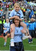 26 September 2010; Claire Kennedy, Dublin, celebrates with her eight year old daughter Josline after the game. TG4 All-Ireland Senior Ladies Football Championship Final, Dublin v Tyrone, Croke Park, Dublin. Picture credit: Dáire Brennan / SPORTSFILE