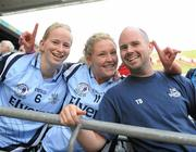 26 September 2010; Dublin players Sorcha Furlong, left, and Amy McGuinness celebrate with Selector Tommy Brown after the game. TG4 All-Ireland Senior Ladies Football Championship Final, Dublin v Tyrone, Croke Park, Dublin. Picture credit: Dáire Brennan / SPORTSFILE