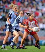 26 September 2010; Sarah Donnelly, Tyrone, in action against Denise Masterson, right, and Amy McGuinness, Dublin. TG4 All-Ireland Senior Ladies Football Championship Final, Dublin v Tyrone, Croke Park, Dublin. Picture credit: Dáire Brennan / SPORTSFILE